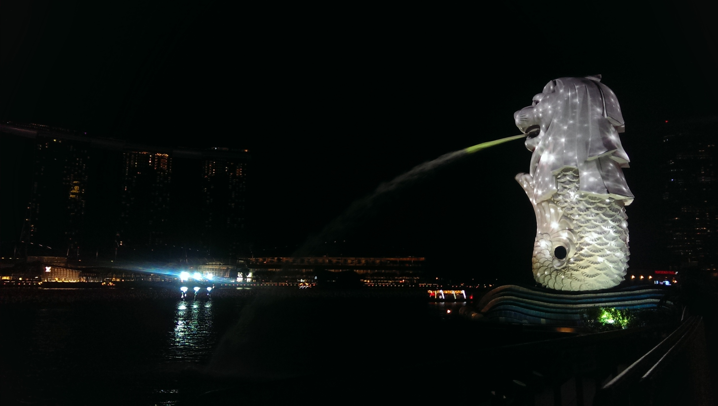 the evening Merlion gurgitating into the Marina Bay.
