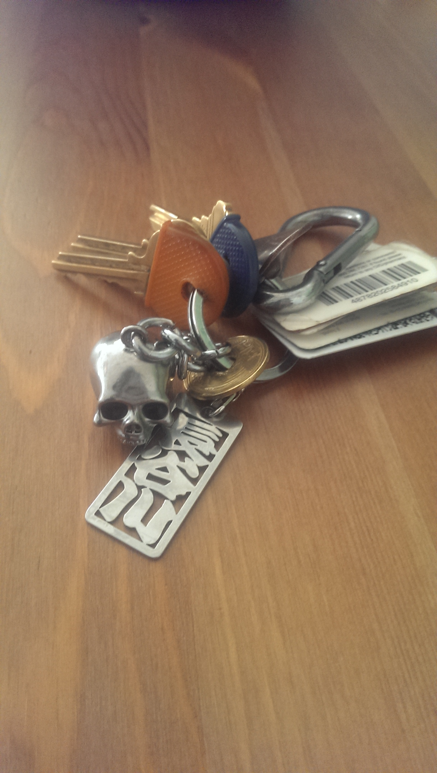 Keys, I surround my house keys with a skull keychain from my art professor, a japanese 5yen piece for good luck and my family name.