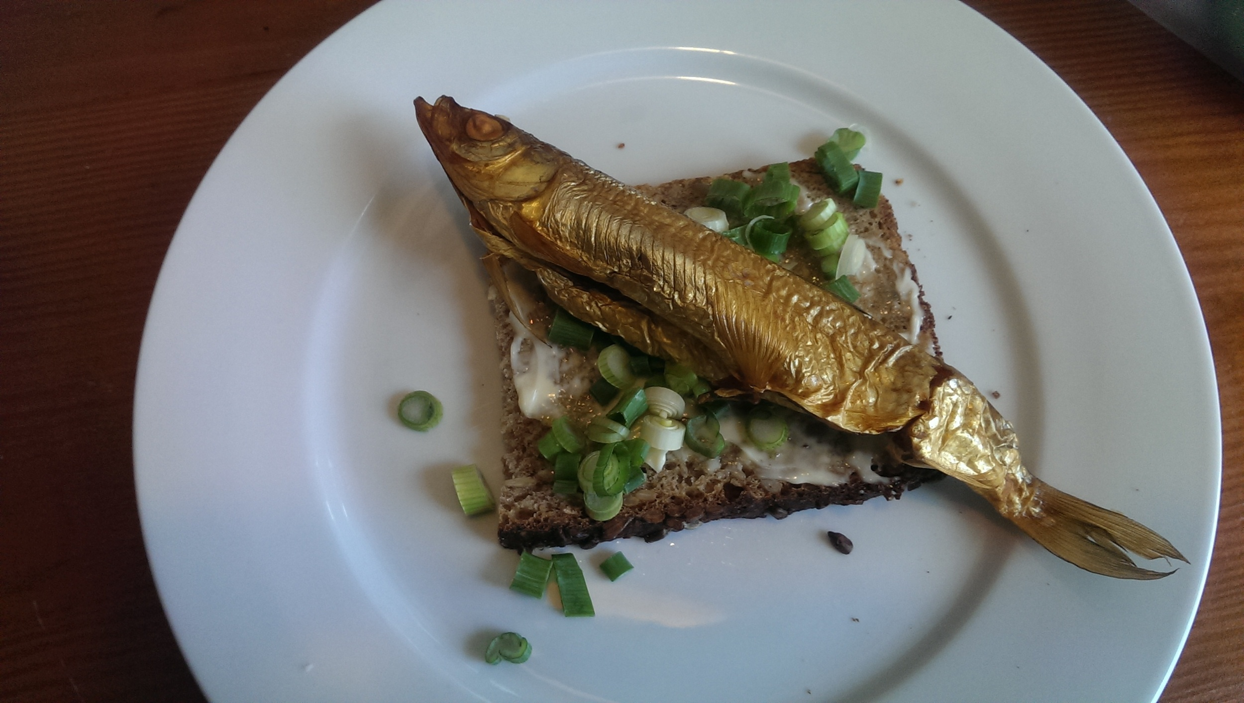 Smoked Chub Fish on sunflower seed rye with scallions ... before.