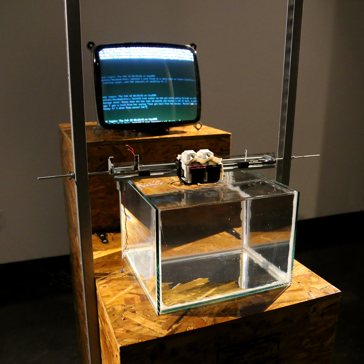 Water Printer - A machine designed to attempt and fail to print on the surface of water.