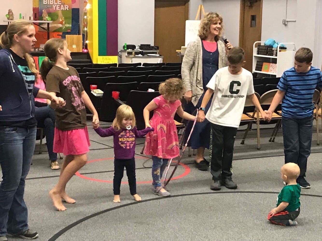 Holding hands, which represented our promises, we had to pass the hula hoop around the circle without letting go; or as was taught to us; breaking our promise.