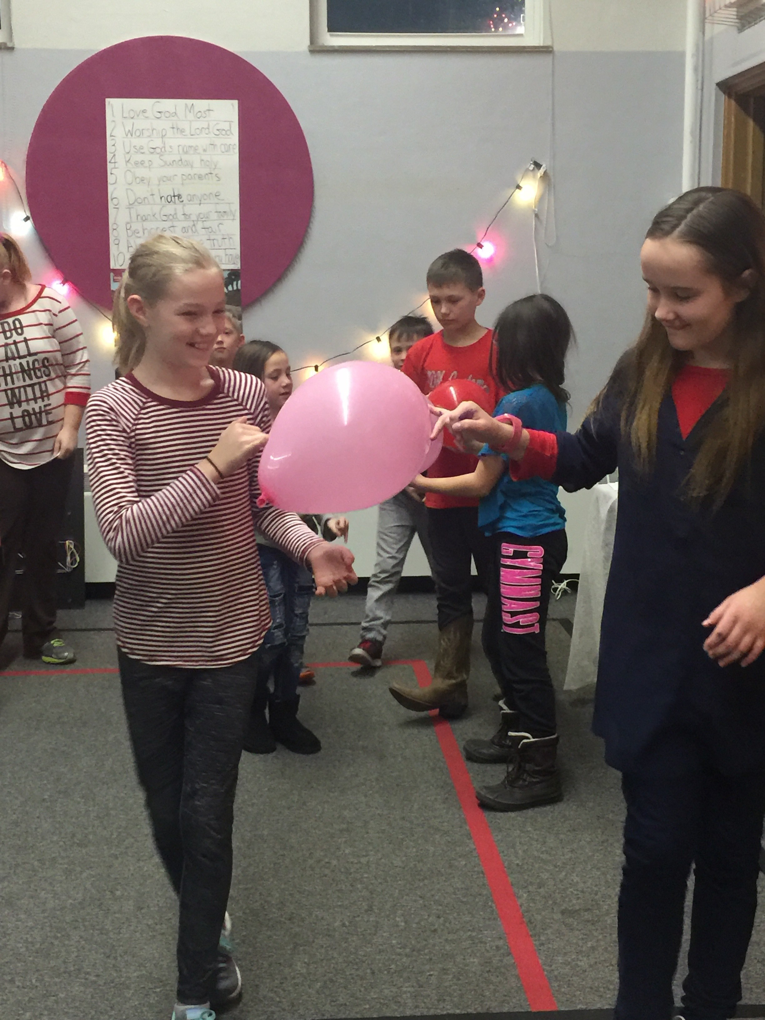 Our lesson tonight was on Naomi and Ruth and traveling from Moab to Bethlehem. We worked in teams of 2 and had to 'travel' with the balloon held a certain way. Our Naomi and Ruth (aka Daisy) started the journey. The could only hold the balloon by their pinkies.