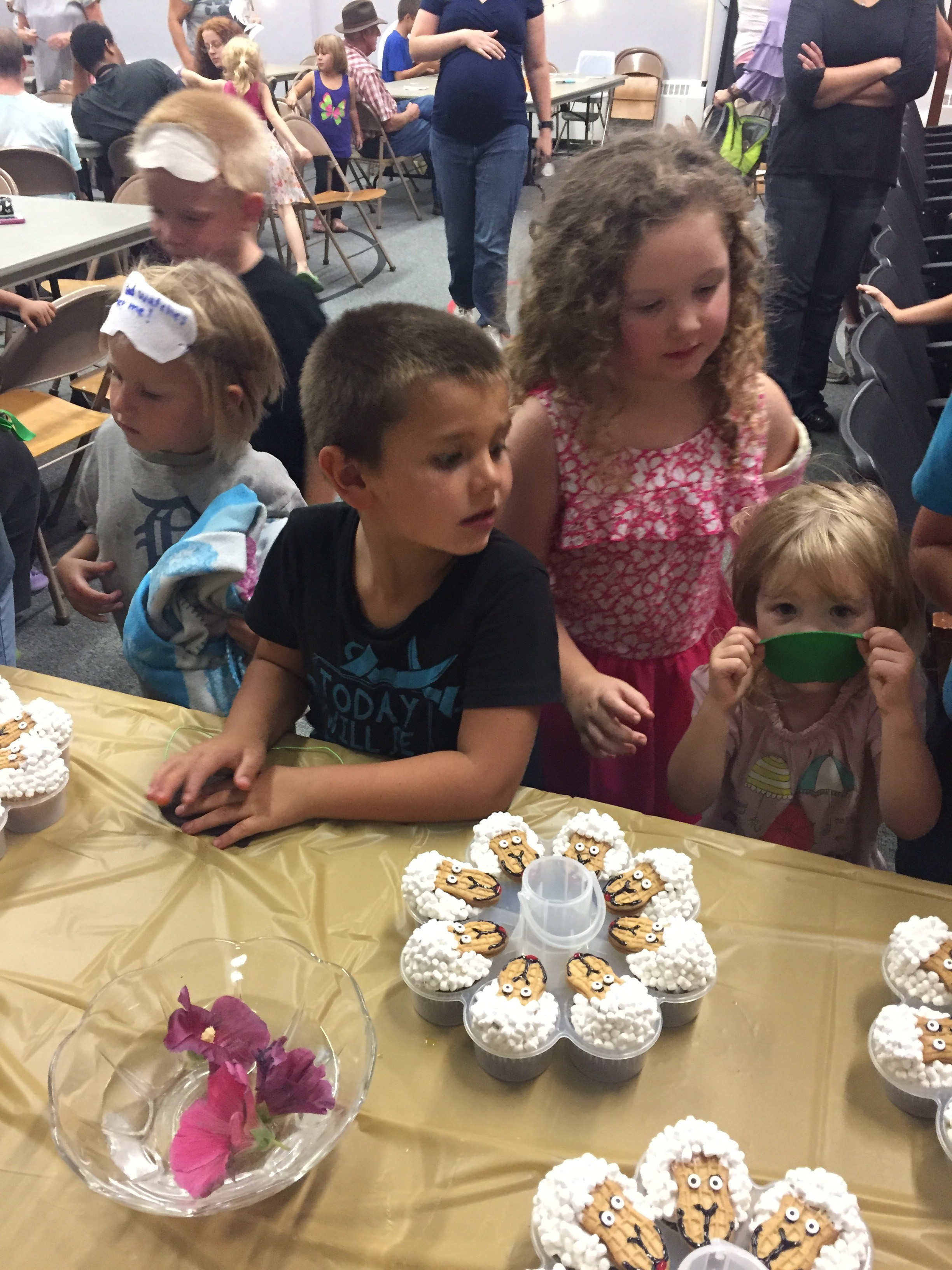 Waiting for snack. Thanks to Miss Katie for making our cute sheep cupcakes that went with our lesson.