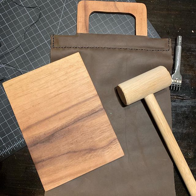 Working on a leather lunchbox with a built in walnut cutting board and walnut handle.