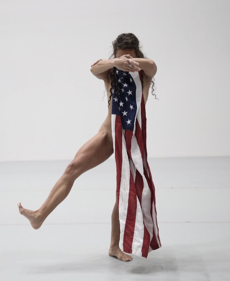 Mary Kate in Yvonne Rainer's  Trio A with Flags  performed at New York's Museum of Modern Art  Photo by Paula Court, Museum of Modern Art