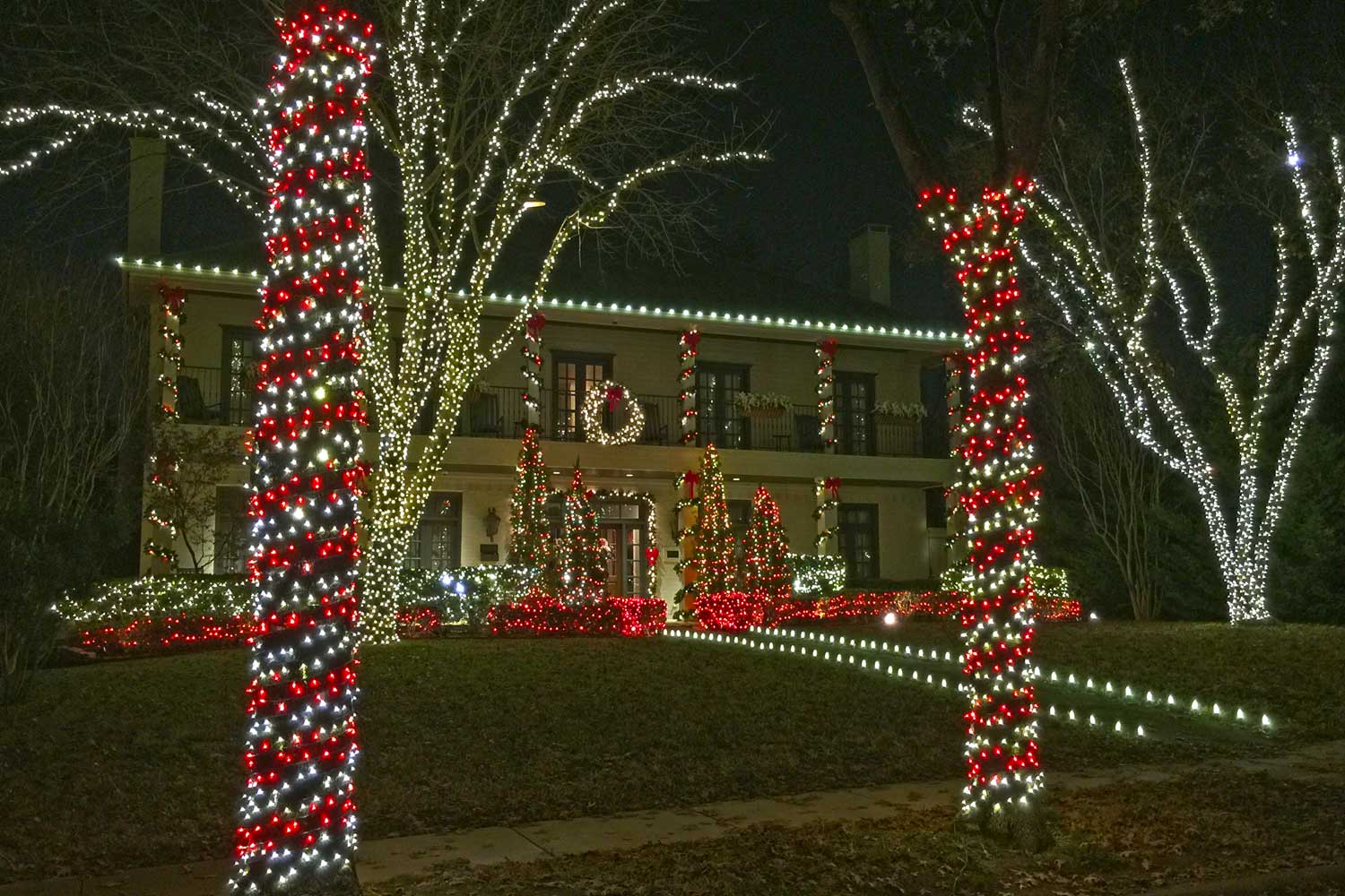 One of several wonderfully lighted homes on Centenary Drive in University Park. Love the candy cane striped trees.