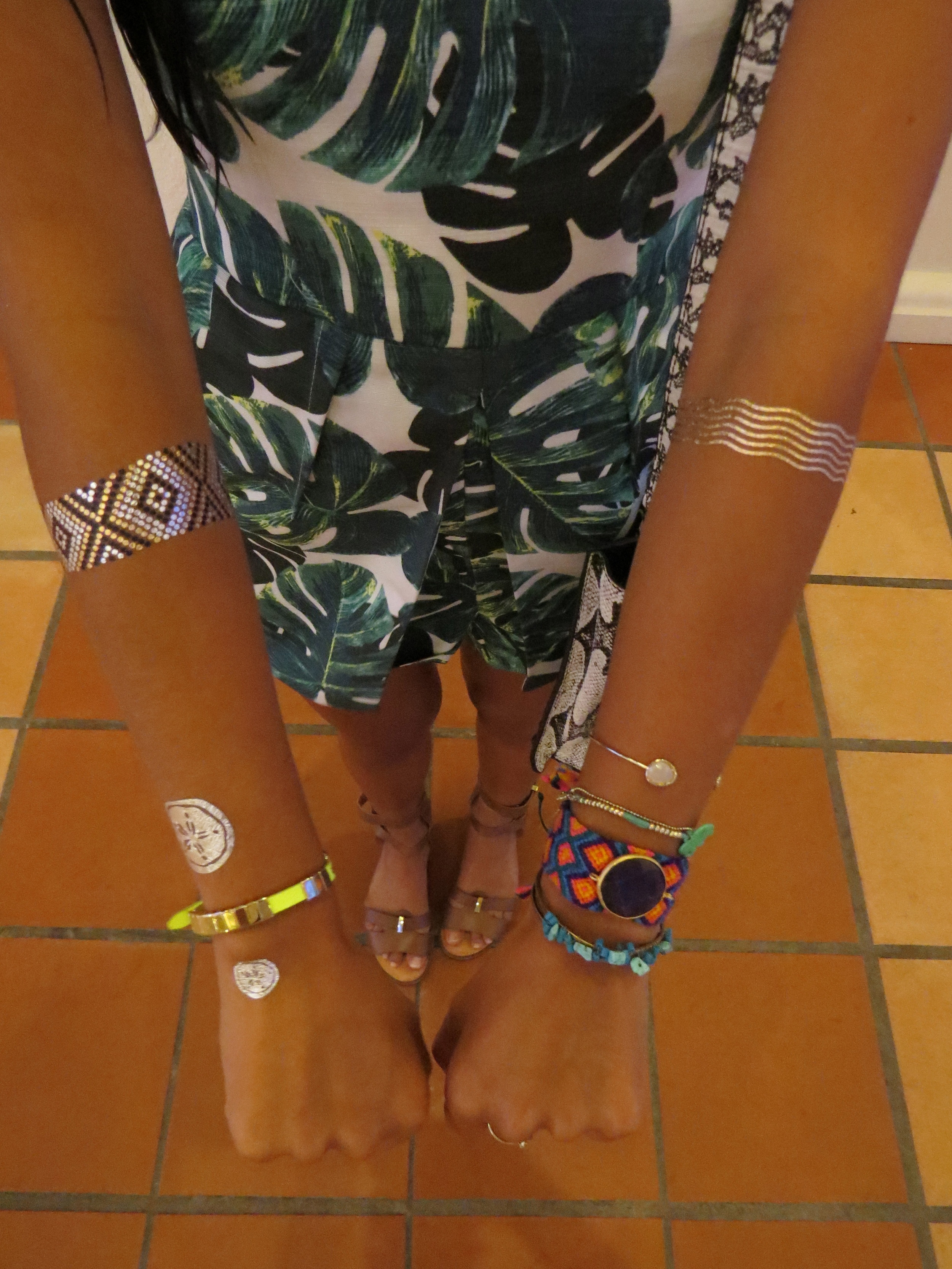 (From top to bottom & Left to Right) Flash Tattoo, Goldfish Kiss H2O; Michael Kors Neon Yellow Bracelet; Gold Cuff w/ Stone, LF; Two-Strand Teal Bracelet w/ Elephant, Antique Shop; Gold w/Turquoise Stones, Nordstrom.