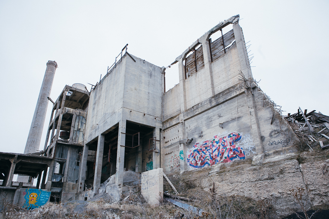 It turns out to formerly be a cement factory, and currently a canvas for graffiti.