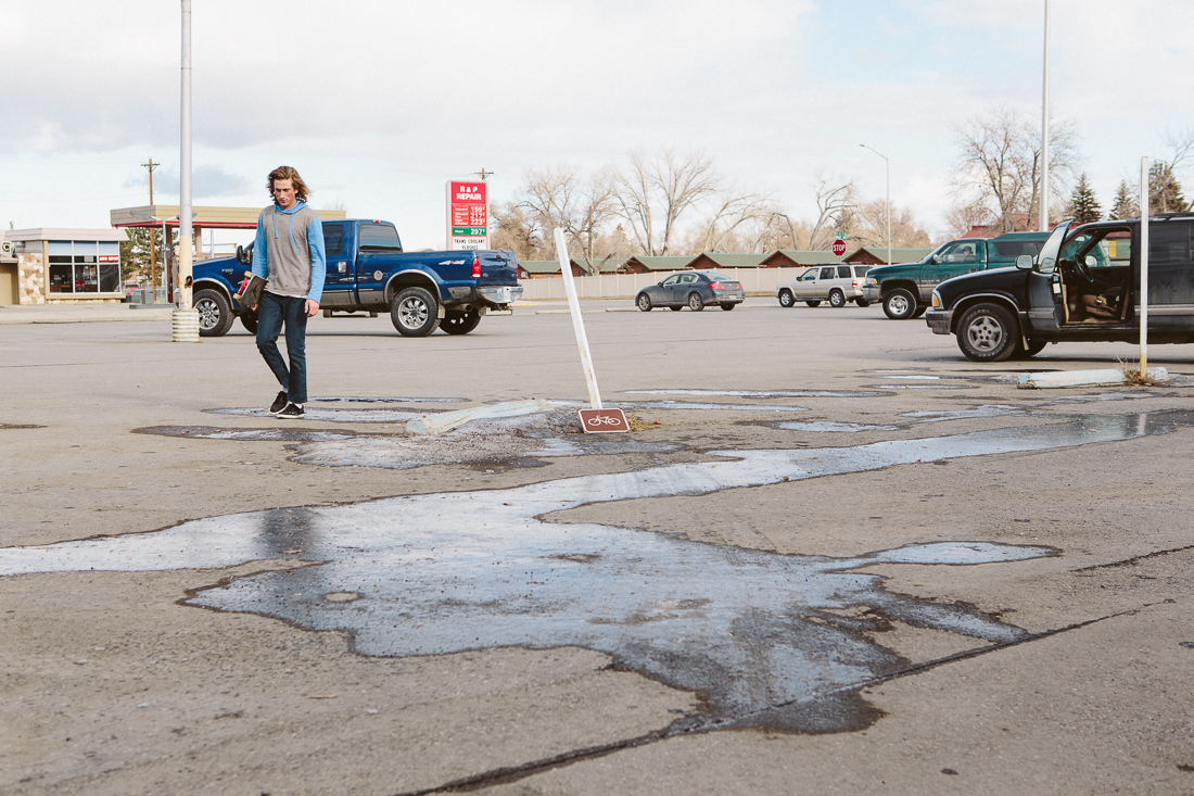 In the town of Cody (Home of Buffalo Bill) I met John Wells, a local up-and-coming skateboarder. He told me of this insane polejam he wanted to hit. There werea couple ice patches in the runway, but wanted to do it anyways.