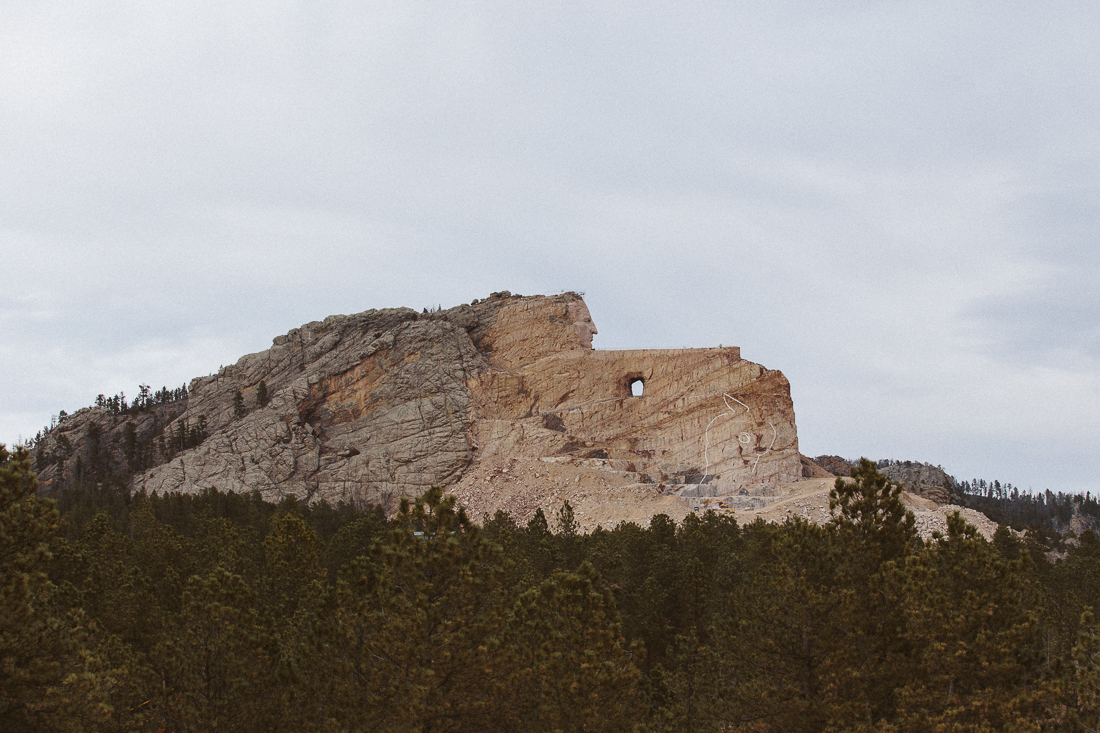 This isa  monument  in progress dedicated to the Native American Crazy Horse. The story is tragic, the US Federal Government betrayed and murdered him. You should read about it to make your own opinion on the topic.