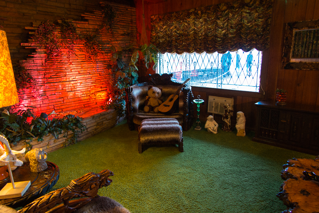 In one ofhis numerousliving rooms was a scene fullof shag carpet, which was even on the roof for nicersound acoustics. The waterfall, just for looks I suppose.