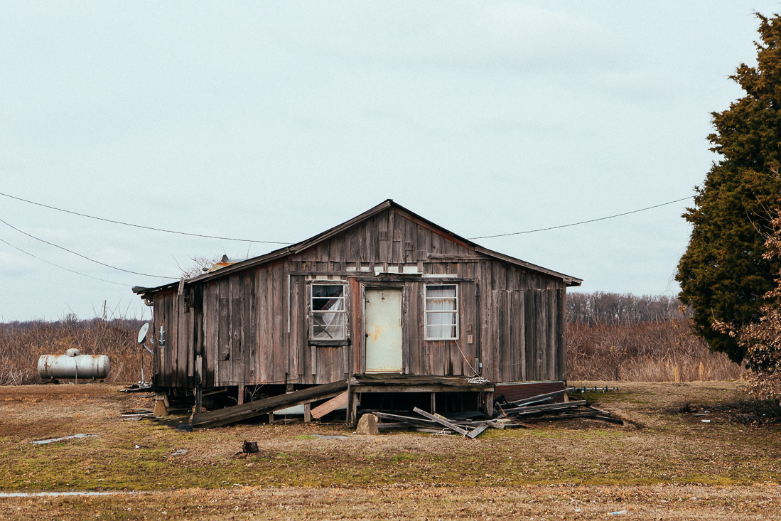 This house may appear to be a shack, but they have satellite television. ...don't be quick to judge.