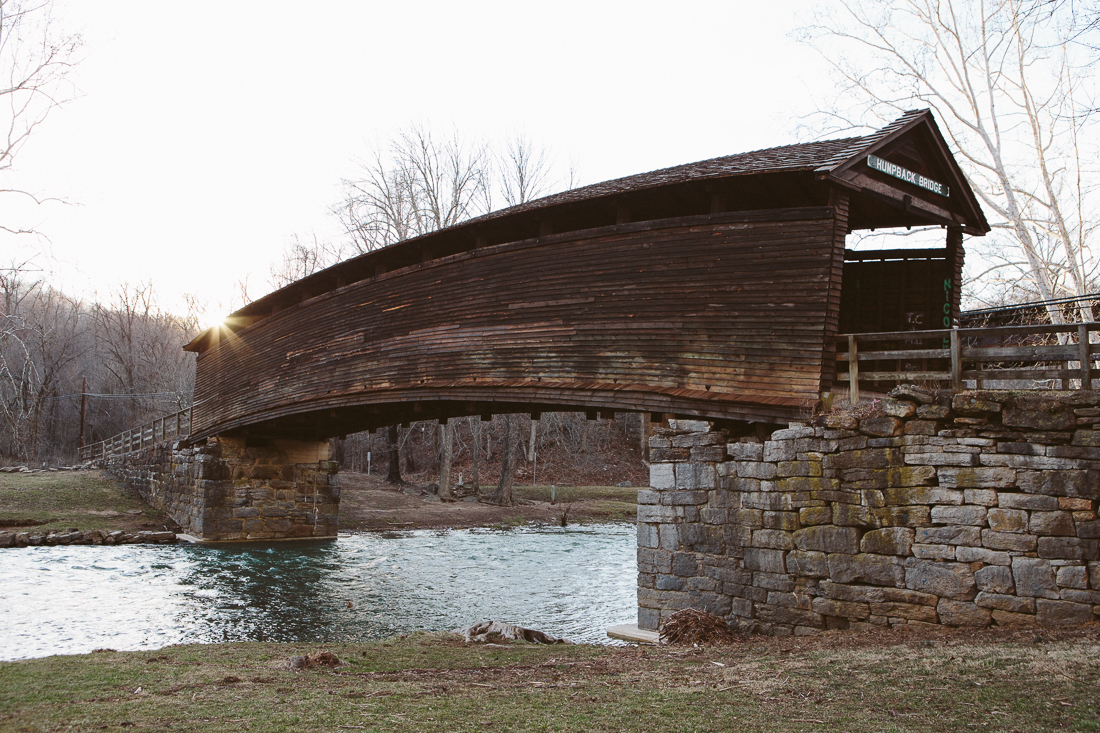"""Covered bridges are plentiful on the East Coast, but this is one of a few remaining """"humpbacks"""" that rise in the center."""