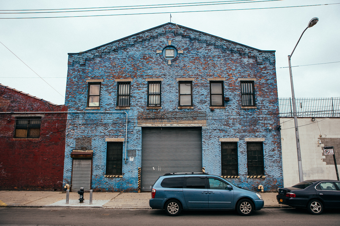 The weathered painted brick on this building is something you can't recreate without time. The blue vehicle really made this picture come together.