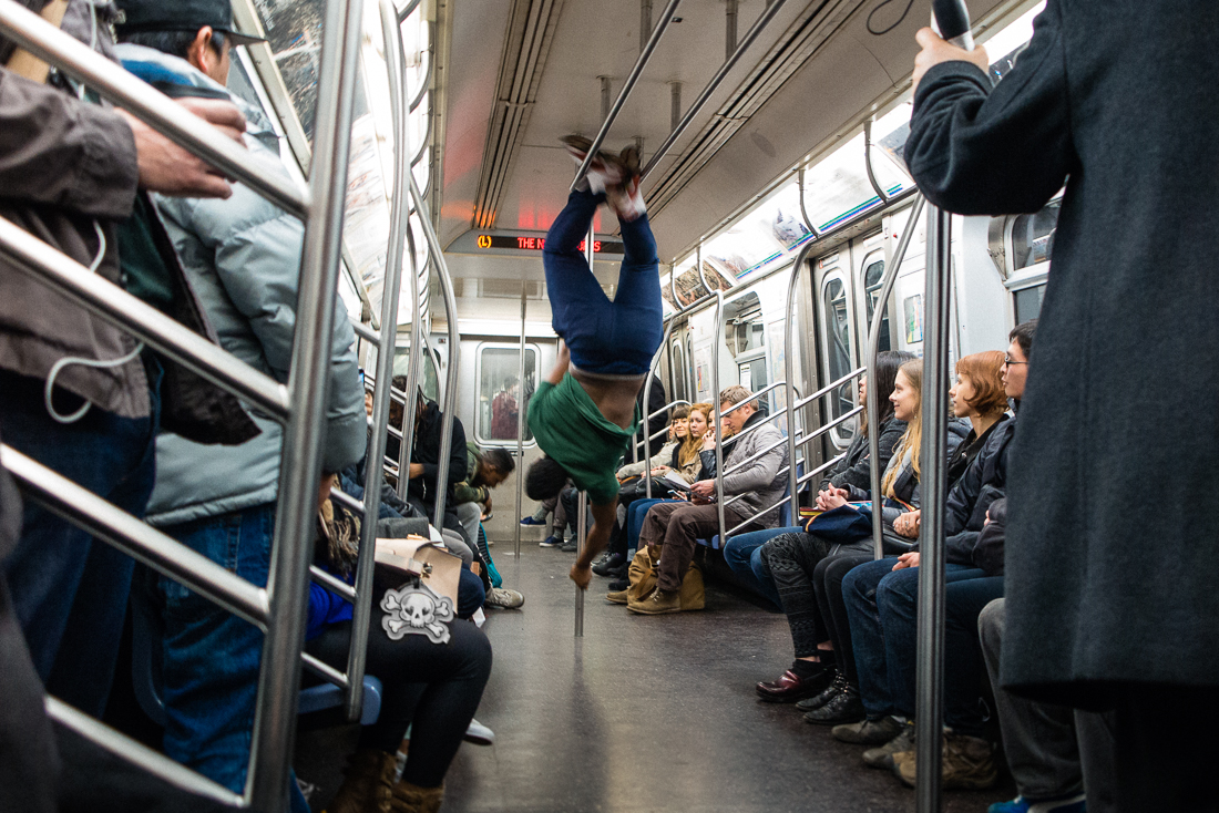 People are always hustling in the city. There are classic panhandlers and then there are performers... this dude had a gymnastic routine on the L train.