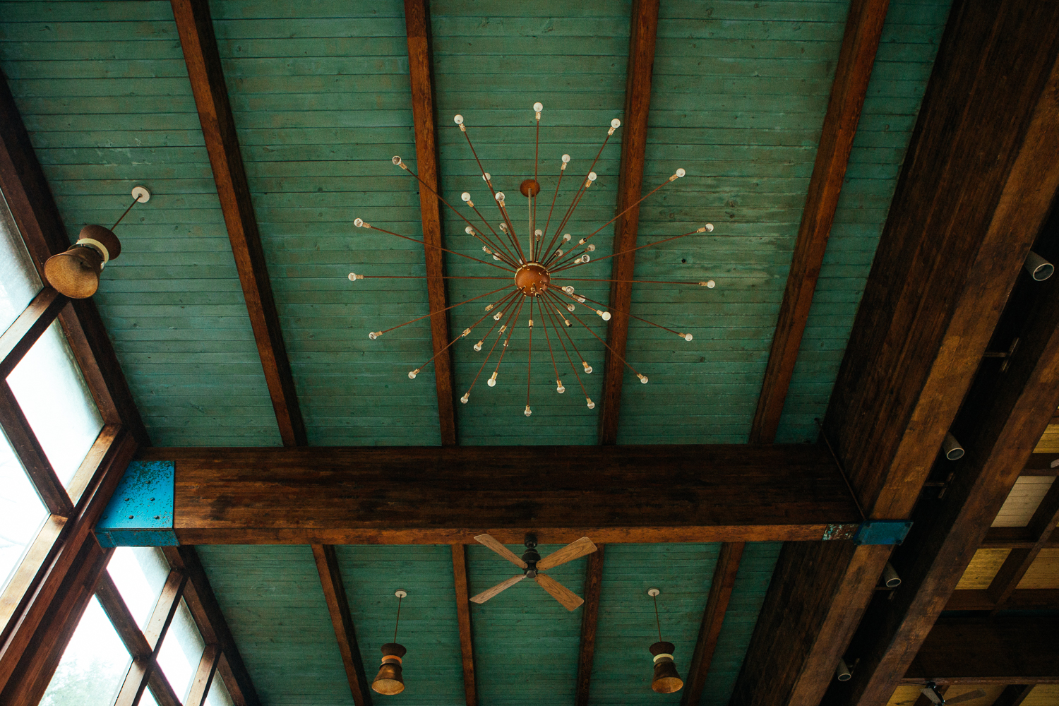There also is still the beautiful midcentury modern chandelier and fans.