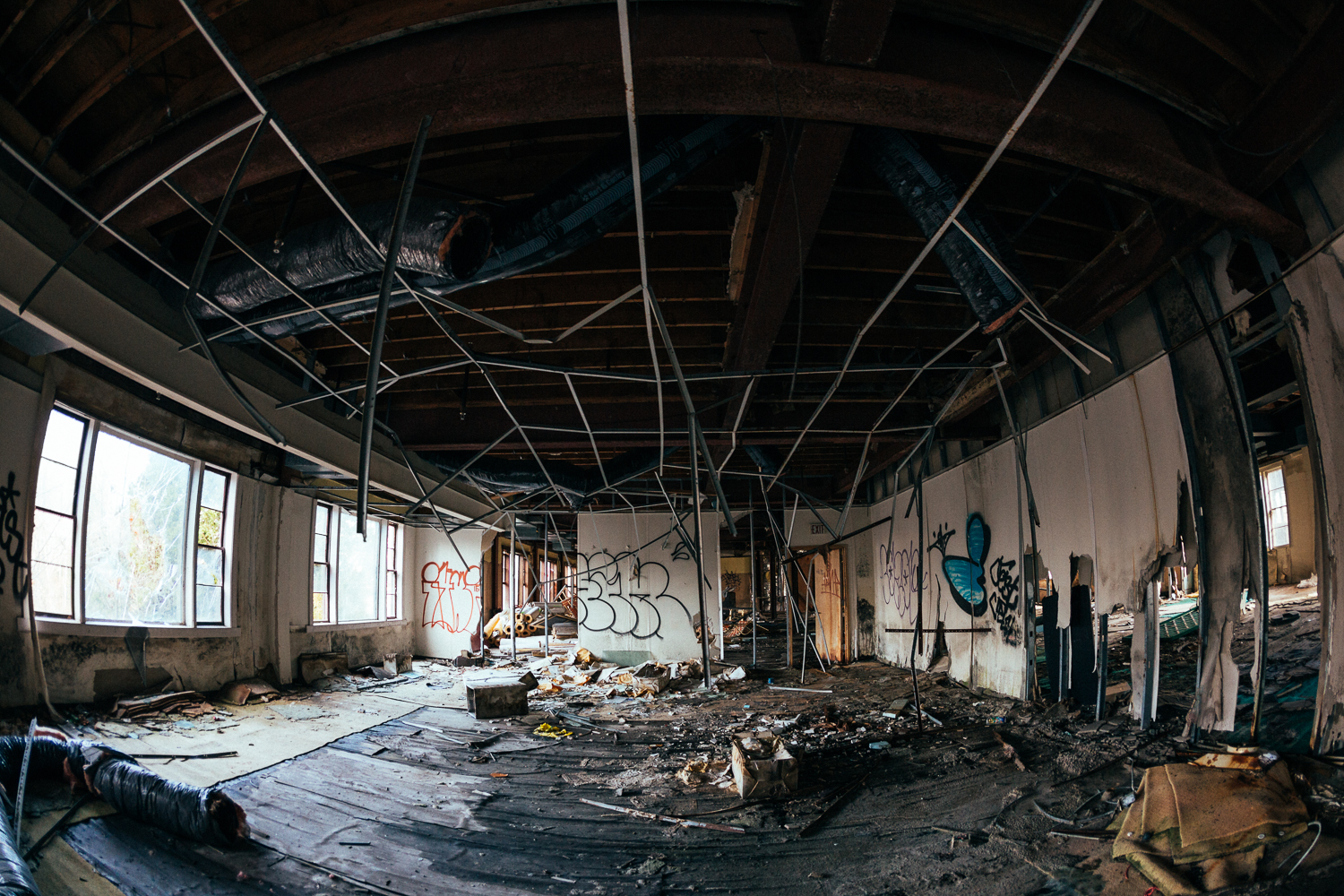 Roofs falling in, asbestos infested walls, soggy floors collapsing. This is why it's off limits!