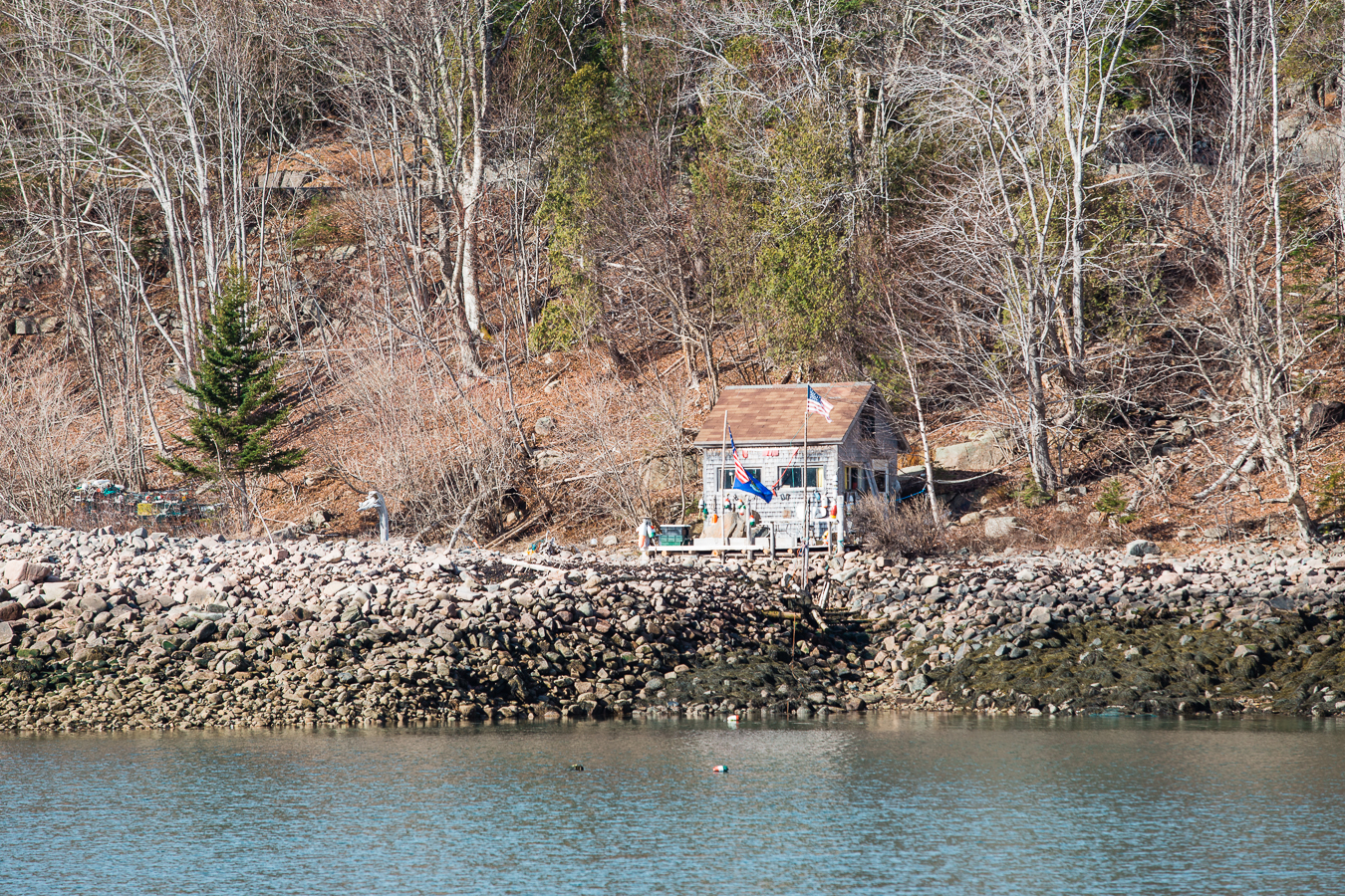 Someday I'll have a fishin' hut like this,where we'll drink whiskey and tell long winded stories.
