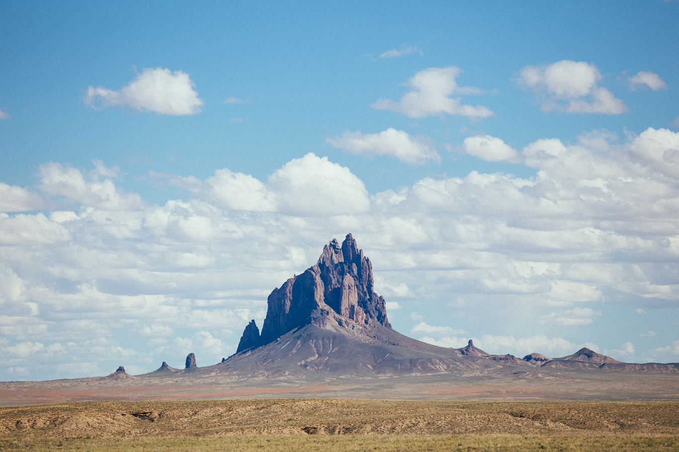 Shiprock. There areno rivers or ocean for days, so I could see how you could get this formation confused for a boat.