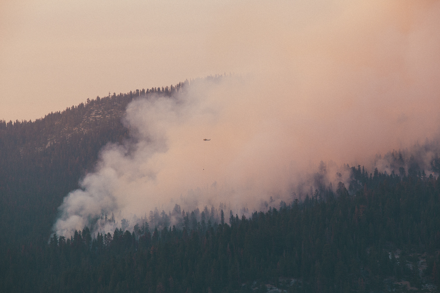 By the time I made it up the hill,the fire had already spread hundreds of acres. Firefighting crews were already on it, dropping flame retardant from air tankers and huge buckets of water from their helicopters. Somebody hadn't been listening to ole Smokey The Bear.