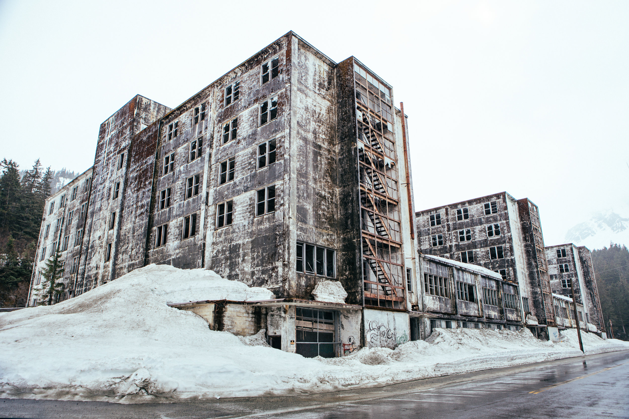 """Once upon a time this place use to house everybody in the entire town and had all the stores, school,hospital, and everything, basically to make it a """"city under one roof""""since the weather gets so bad here. After the great Alaska Earthquake, they built a new one and let this place become a zombie den."""