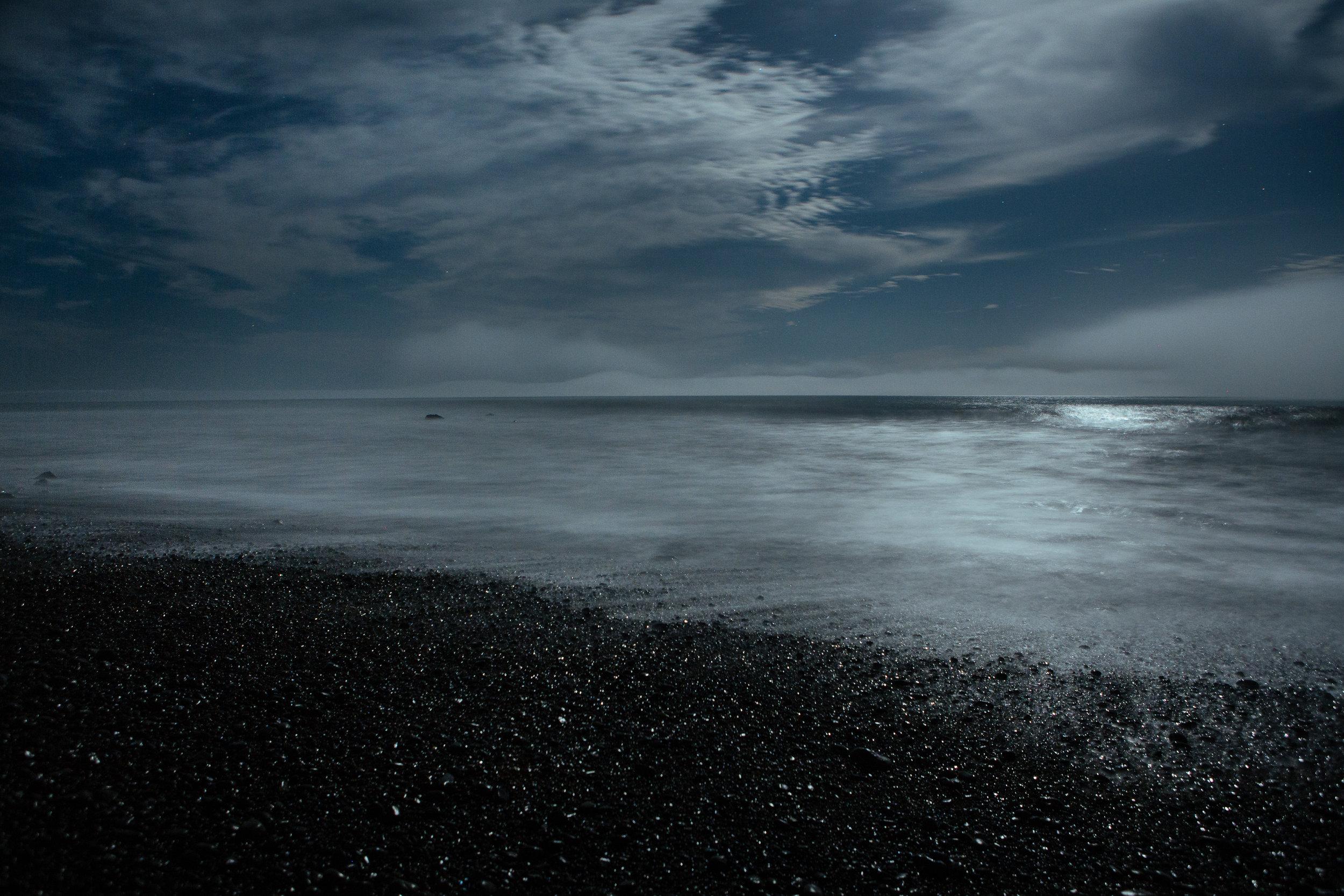 Black marble ocean at midnight.