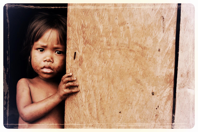 23 girl at wooden door Cambodia.JPG