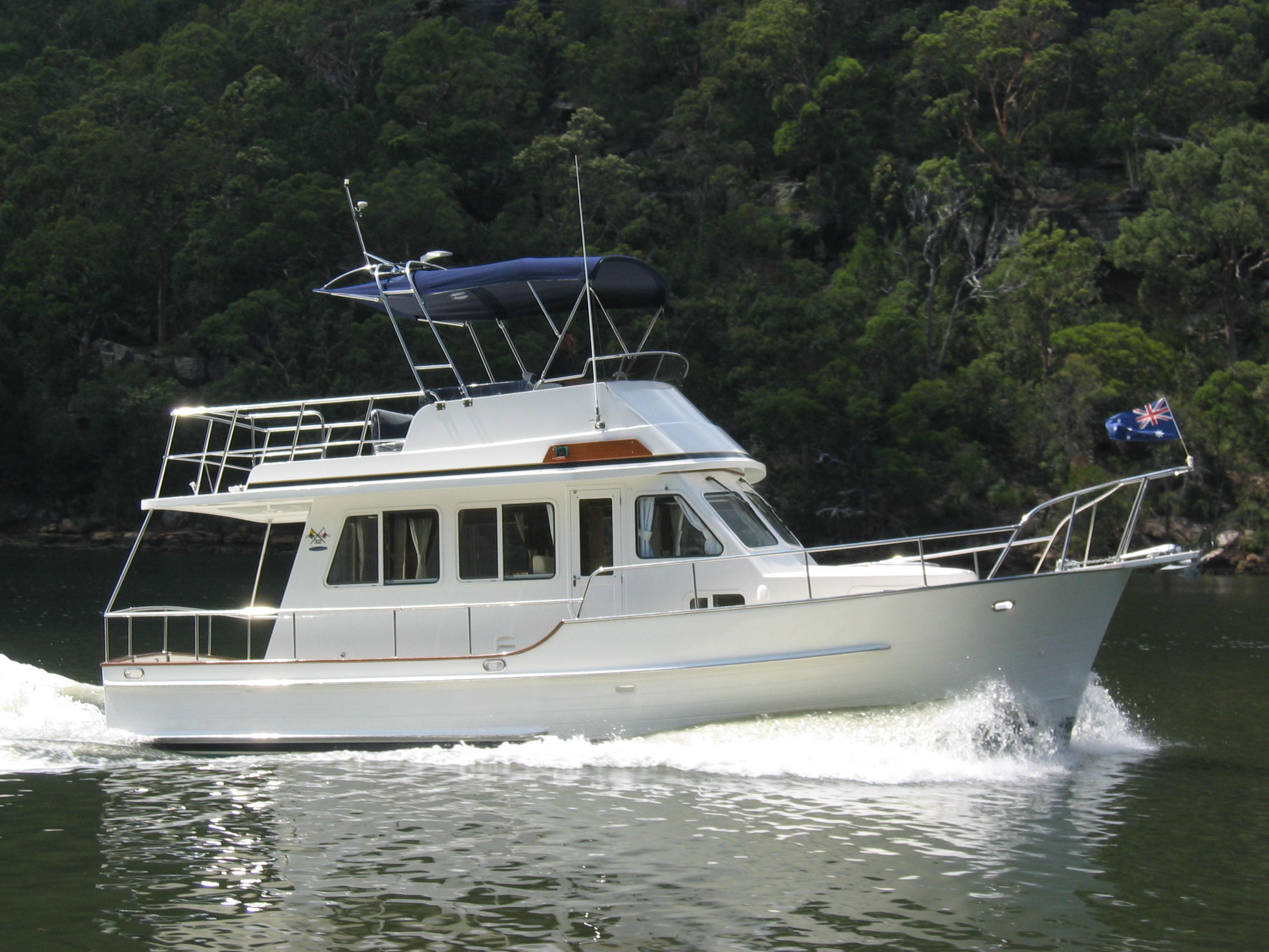 Island Gypsy 32 Eurosedan. Completed in 2006. Cruising up the Hawkesbury River just north of Sydney.