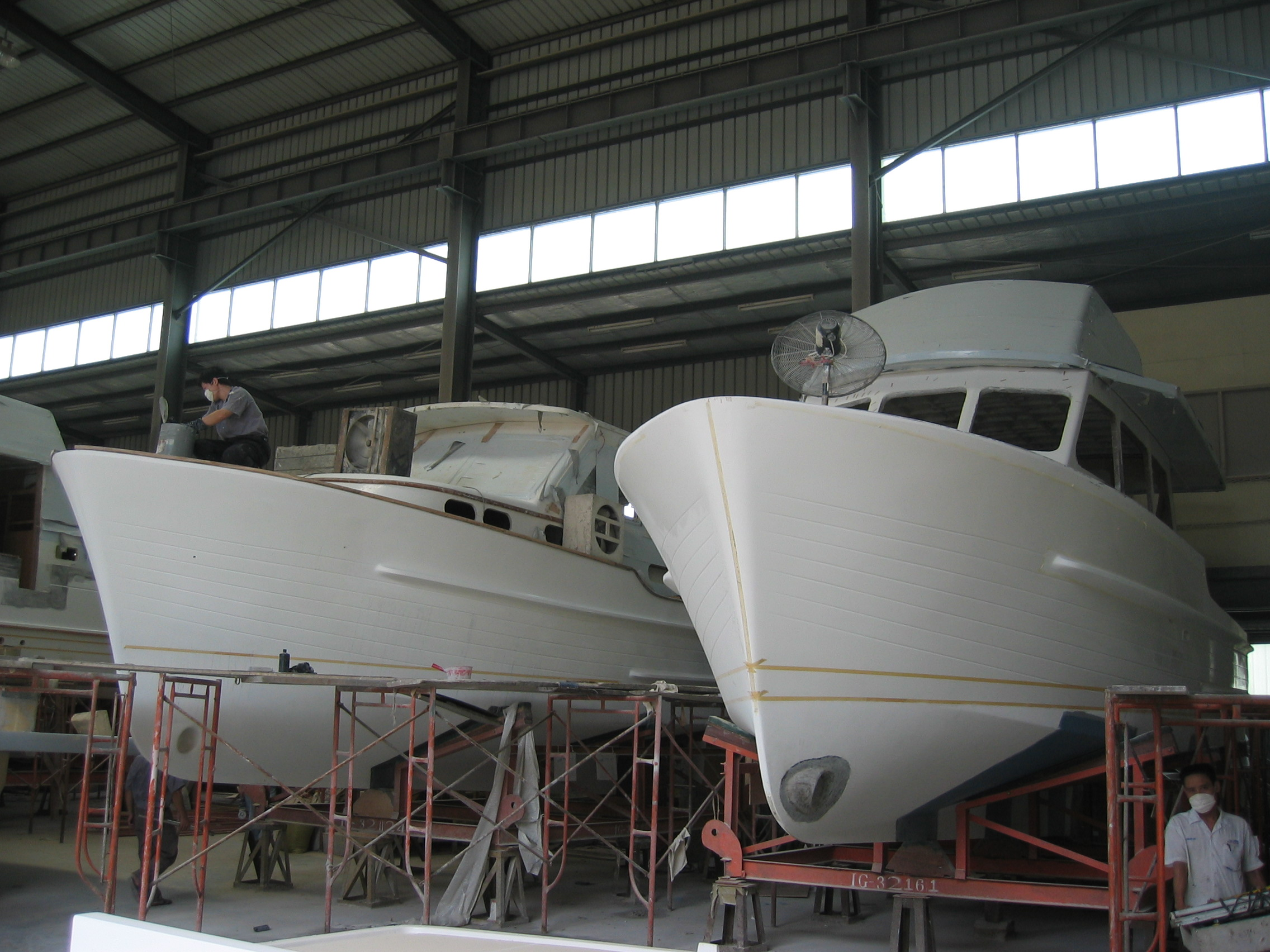 An Island Gypsy 32 and Gourmet Cruiser 32 under construction at Jet Tern Marine Ltd in Dong Guan Southern China. 2005.