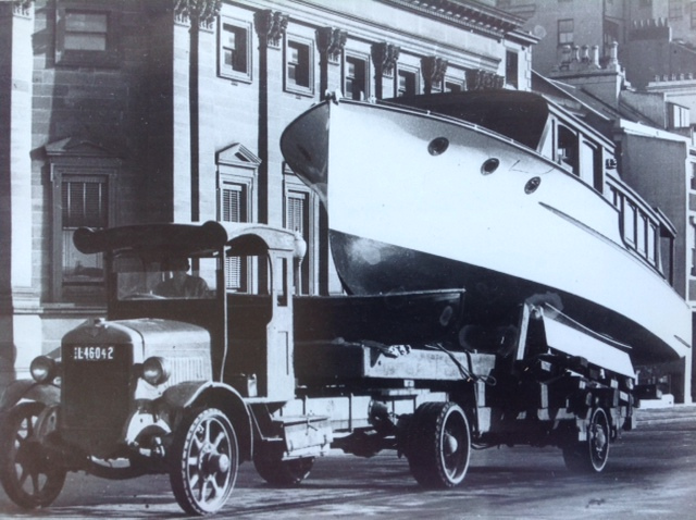 """""""Iolanthe"""" 36' Bridge Deck Motor Cruiser designed and built by L. Halvorsen for Mr. A.G Wilson and completed in June 1933. Photo taken in Macquarie Street on her way to the Sydney Royal Easter Show.  Job number 103."""