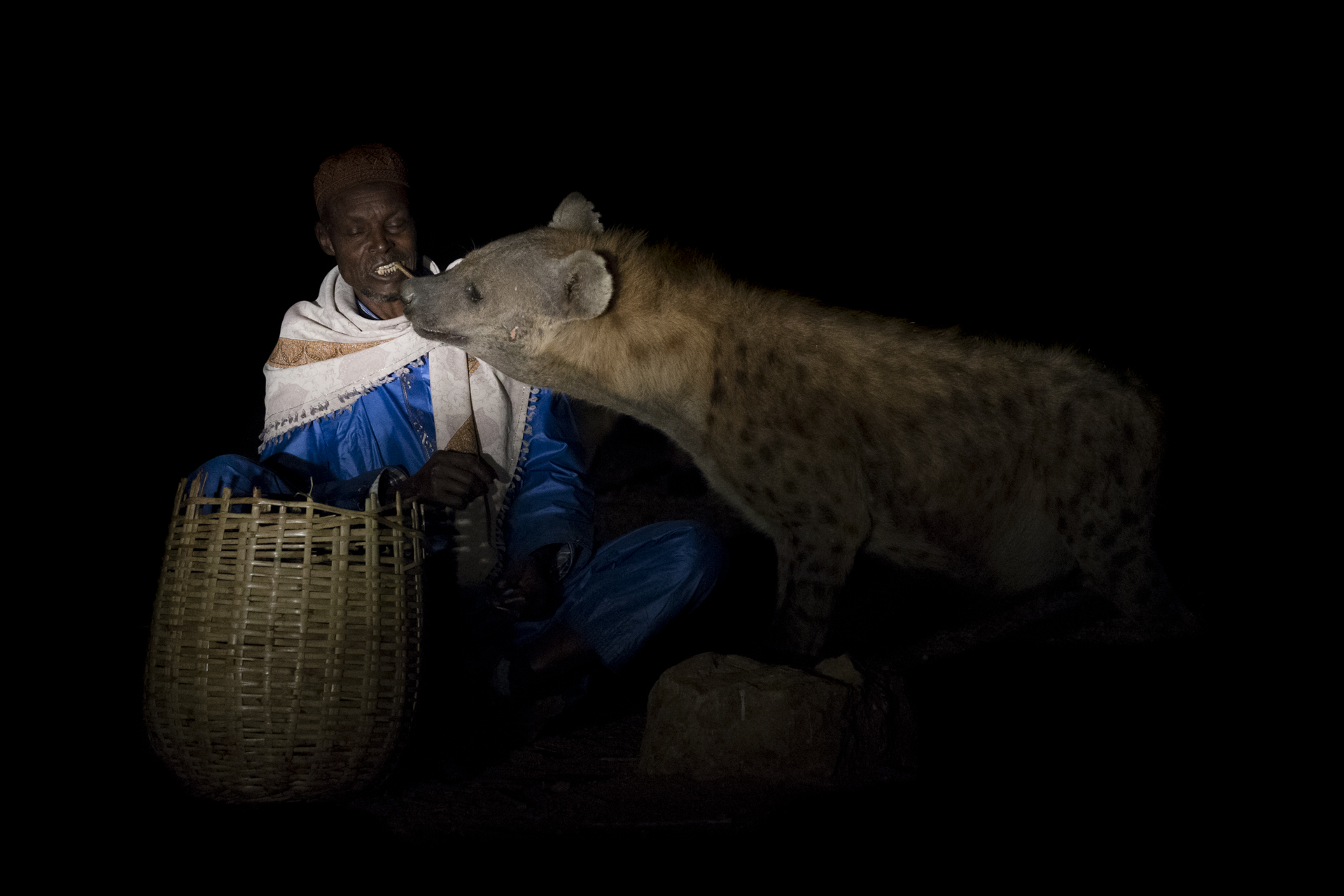 Yusuf is the oldest and one of the last remaining traditional hyena men, still in his traditional garments he feeds the hyenas for the reason he first began, spiritual reasons.