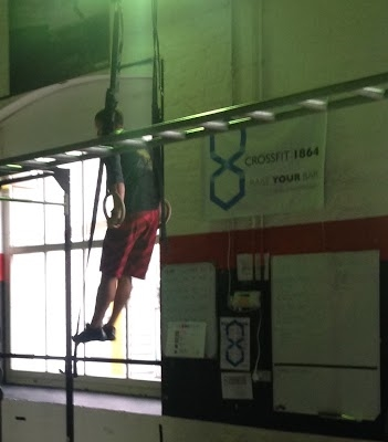 Alex works his way through the muscle ups of 15.3.