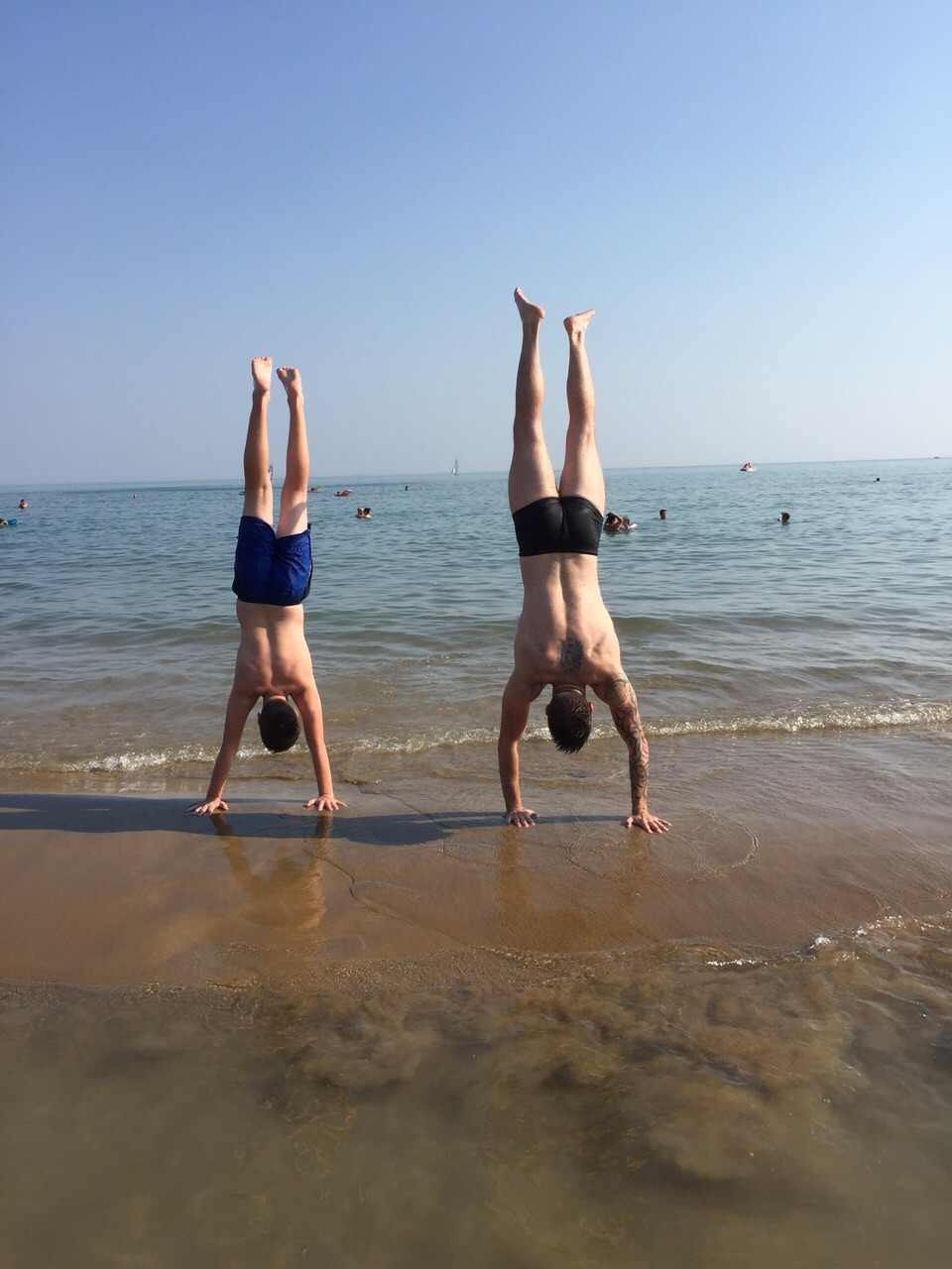 CF1864's resident Father & Son Dream Team, Luke and Luca practicing their handstands on the beach