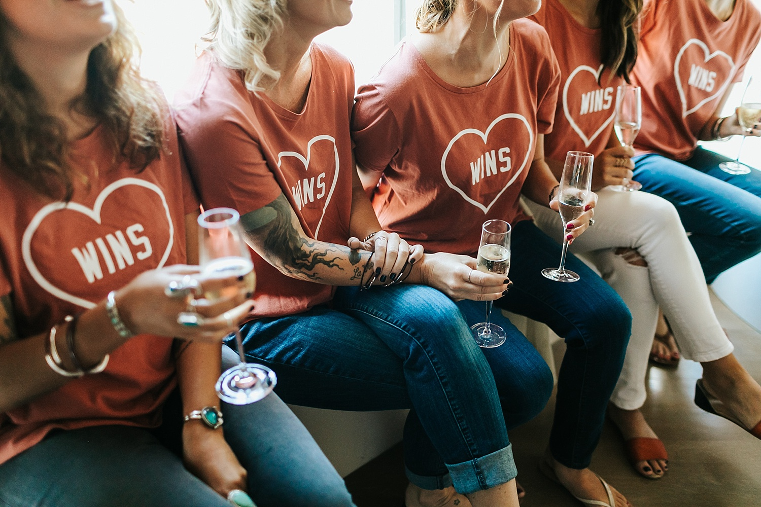 Bridesmaids wearing matching t-shirts during getting ready time at the roundhouse