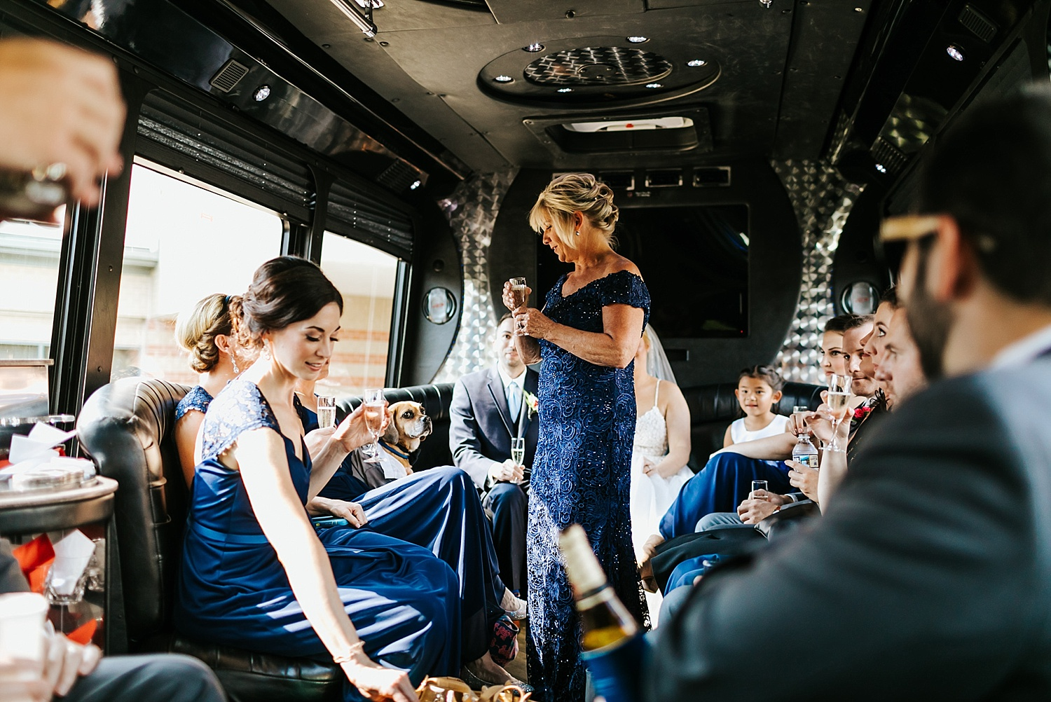 Wedding party celebrating in a limousine