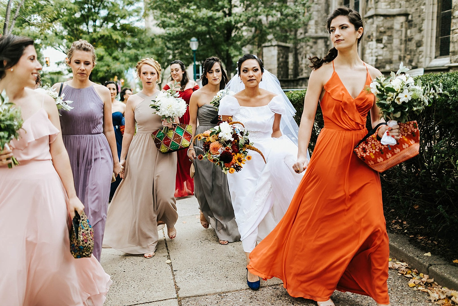 Bride and bridesmaids walking to the ceremony in philadelphia