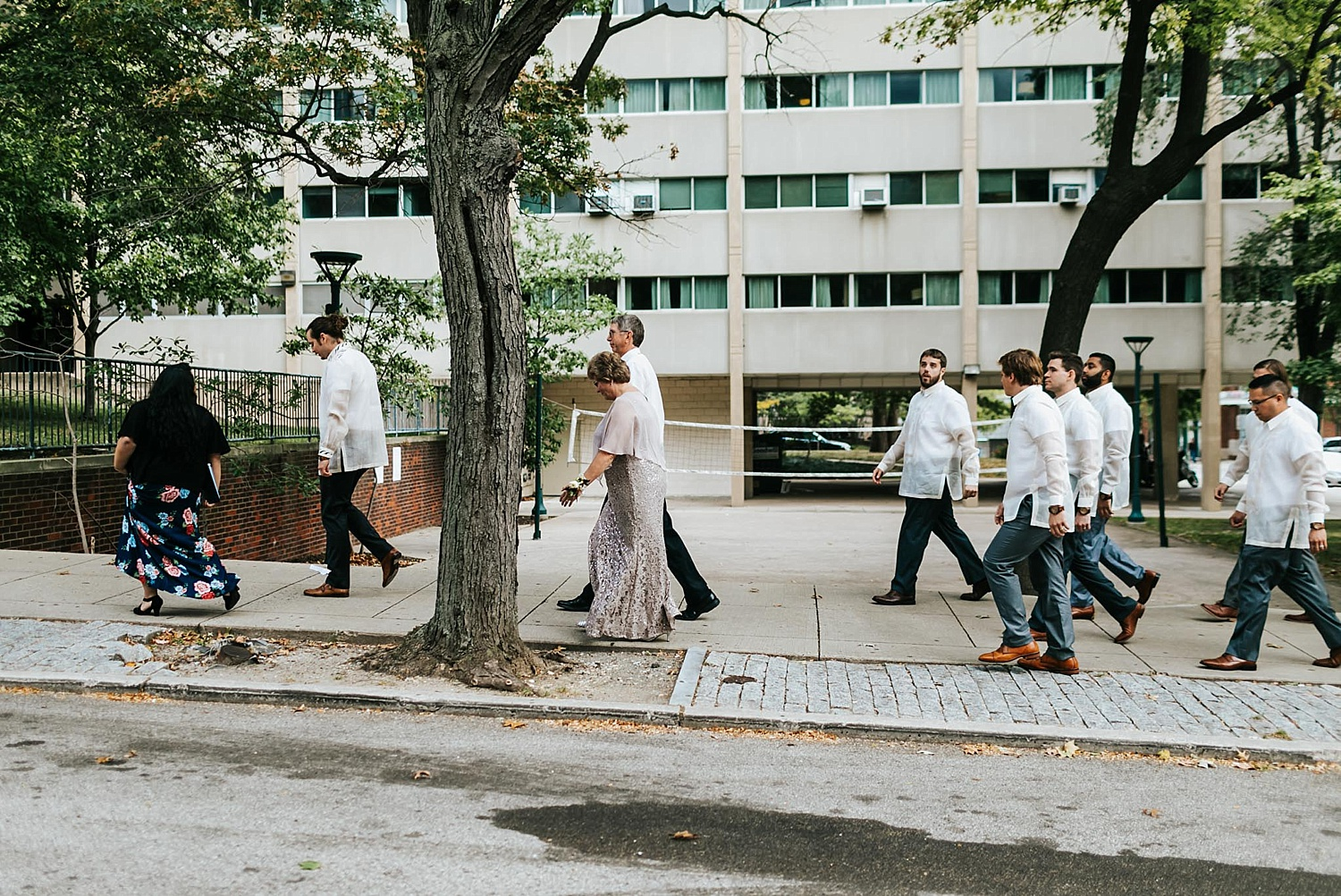 Groom and groomsmen walking to the ceremony
