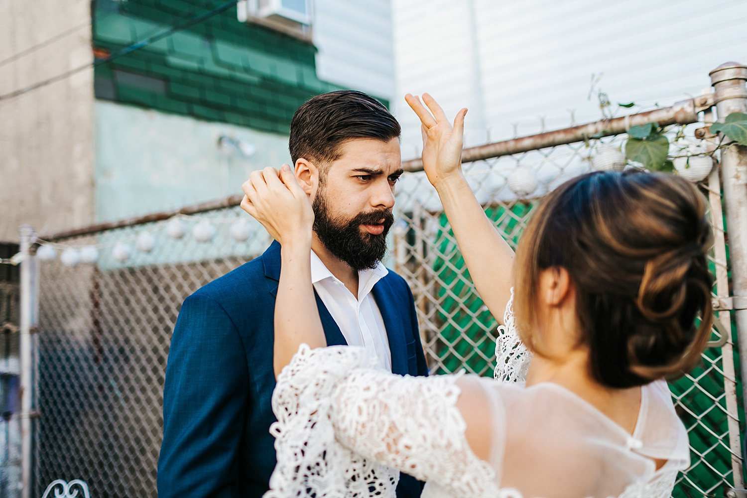 Bride and groom prep at fishtown, philadelphia