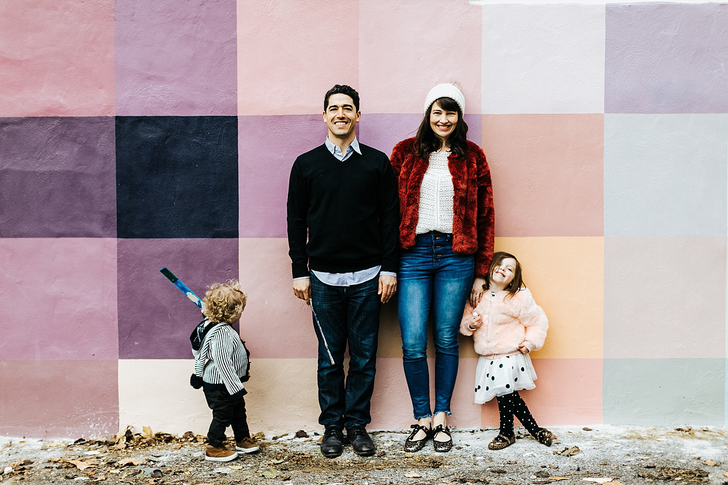 Family standing in front of a mural in philadelphia.
