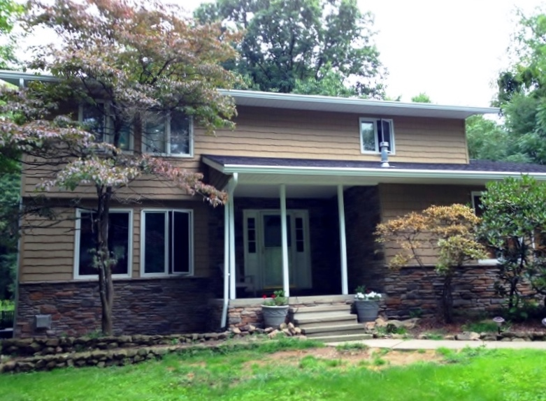 After - Cultured stone with Kaycan Richmond vinyl siding