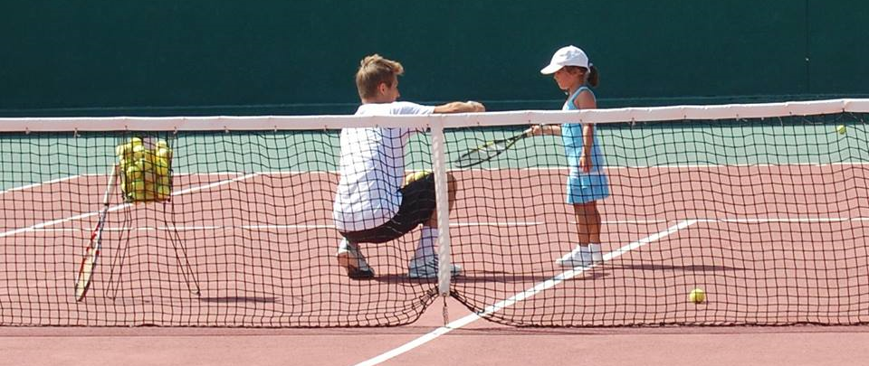 Myself on court with one of my aspiring young students, Mercedes.