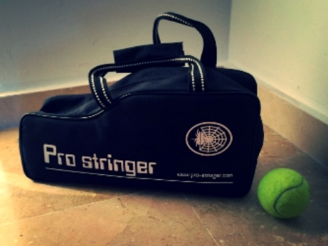 The size of the Pro Stringer packed away is truly mind blowing. Here you can compare it next to a tennis ball.