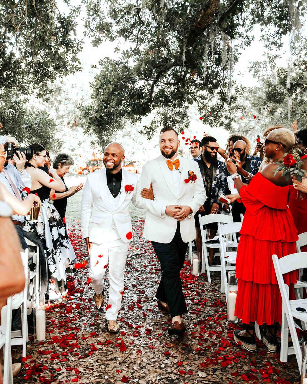 joe-tim-wedding-grooms-recessional-petals-0836-1018_vert.jpg