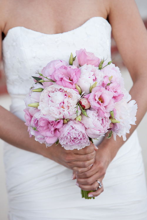 Pink Peonies and Pink Lisianthus create a textural & classic bridal bouquet with a strong pink palette.   (Stacy Kirkwood Photography)