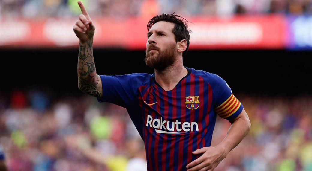 Soccer-Messi-Barcelona-celebrates-goal-against-Huesca-1040x572.jpg
