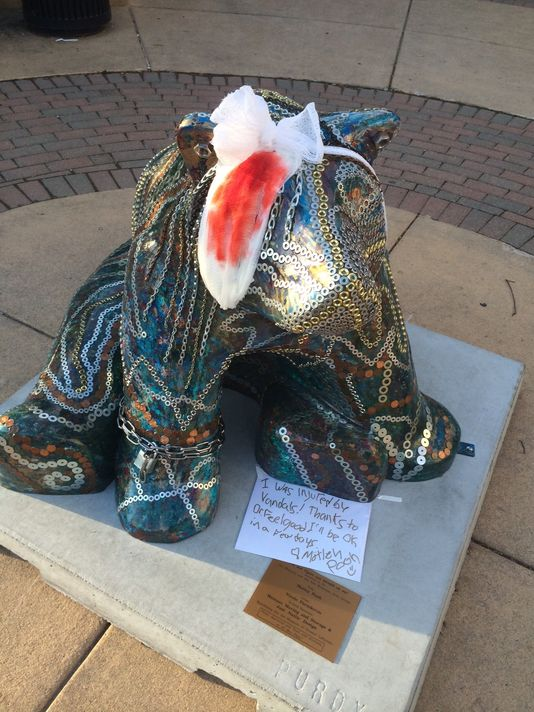 "Nicole Paraskevas added a bandage, get-well-soon card and note thanking Dr. Feelgood for healing ""Motley Pooh"" after she repaired damage caused by vandalism. ""Motley Pooh"" is on State Street by Scotty's Brewhouse in West Lafayette.  (Photo: Photo provided/Nicole Paraskevas)"