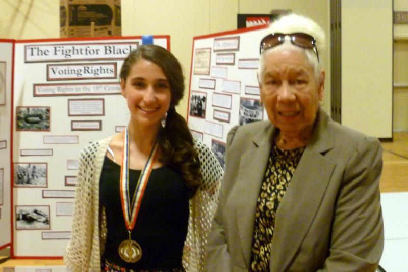 Natalie Lobo and Helen B. Rucker in front of Natalie's winning exhibit.