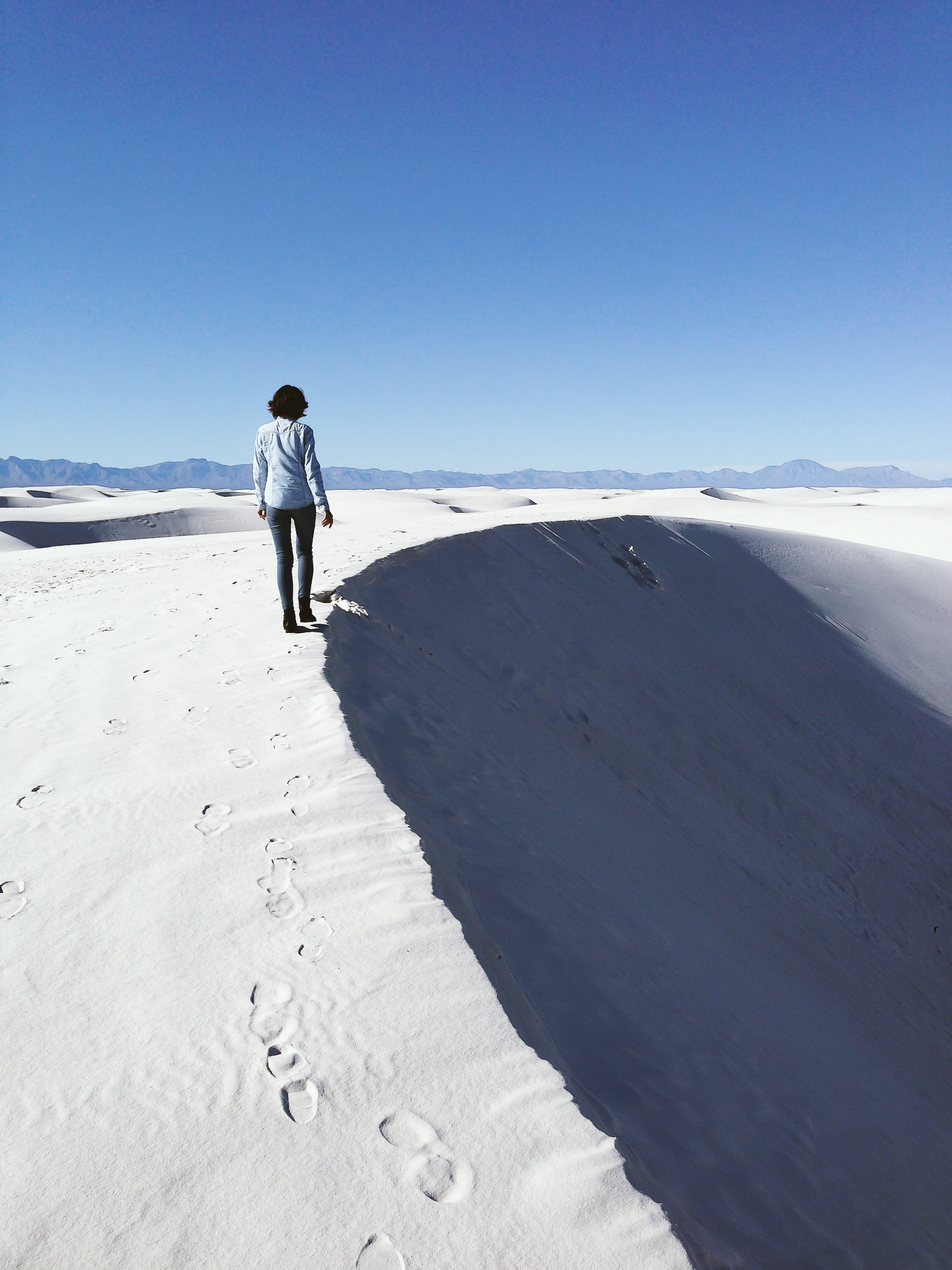 White Sands National Monument, New Mexico:  In 2014, I celebrated my 27th birthday (also my first birthday in the US) at White Sands National Monument in New Mexico. I never saw sand field or sand dune before, let alone sledding on one! That day was well spent, and it has become my favorite place in New Mexico.