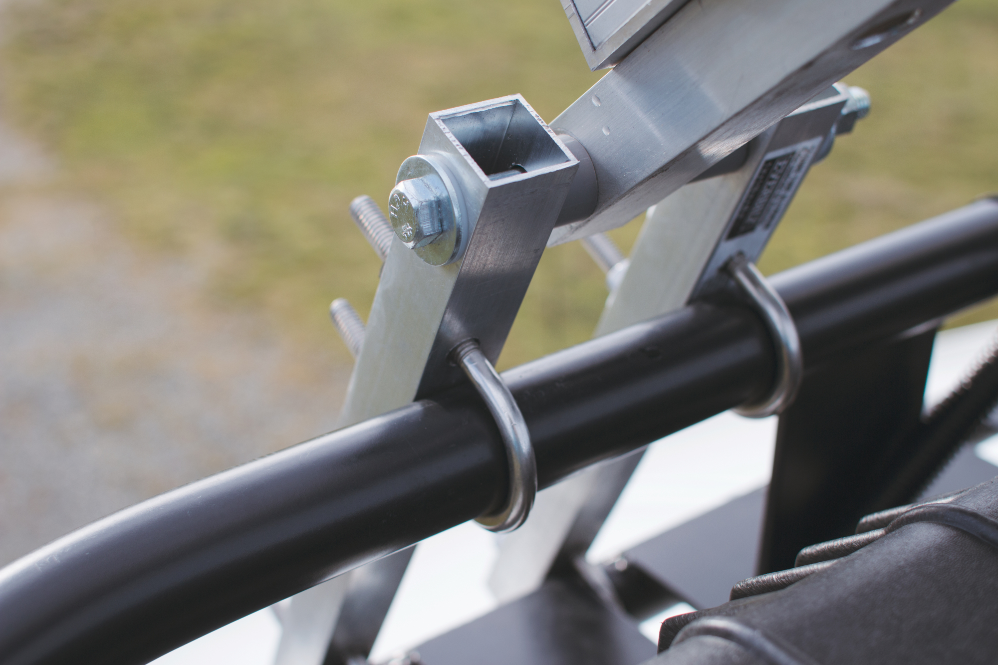 This is the large, custom hinge that Shane created with U-bolts and some steel tubing. The frame for the solar panels came in handy for this part as well.