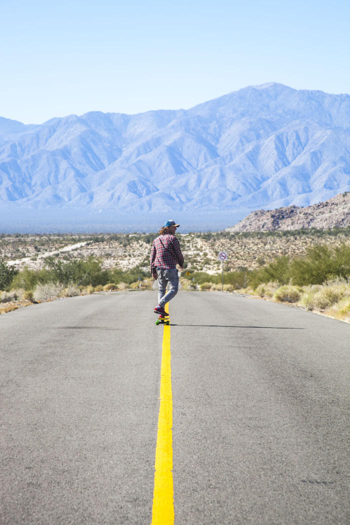 Connan stretching his legs down a Baja California road.